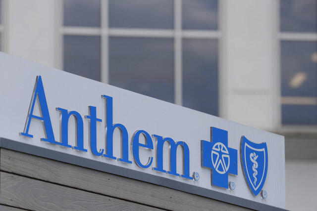 FILE - In this May 14, 2019, file photo signage on the outside of the corporate headquarters building of health insurance company Anthem is shown in Indianapolis.  Anthem started the new year by forecasting earnings that could miss expectations even after the health insurer books gains from a new business. The Blue Cross-Blue Shield insurer expects earnings adjusted for one-time items to exceed $22.30 per share in 2020.    (AP Photo/Michael Conroy, File)
