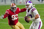 Buffalo Bills quarterback Josh Allen (17) scrambles as San Francisco 49ers defensive end Kerry Hyder (92) pursues during the first half of an NFL football game, Monday, Dec. 7, 2020, in Glendale, Ariz. (AP Photo/Ross D. Franklin)