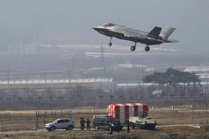 In this March 29, 2019, photo, a U.S. F-35A fighter jet prepares to land at Chungju Air Base in Chungju, South Korea. North Korea on Thursday, July 11, 2019, slammed South Korea for introducing high-tech U.S. stealth fighters, warning that it will respond by developing unspecified special weapons. South Korea is to buy 40 F-35 fighter jets from Lockheed Martin by 2021.(Kang Jong-min/Newsis via AP)