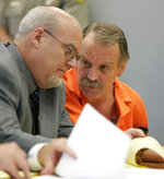 FILE - In this Oct. 6, 2005, file photo, Ron Lafferty, right, confers with his attorney Bill Morrison at his court hearing in the 4th District Courtroom of Judge Anthony Schofield in Provo, Utah. Utah prison officials said Monday, Nov. 11, 2019, that Lafferty, a death-row inmate whose double-murder case was featured in the book