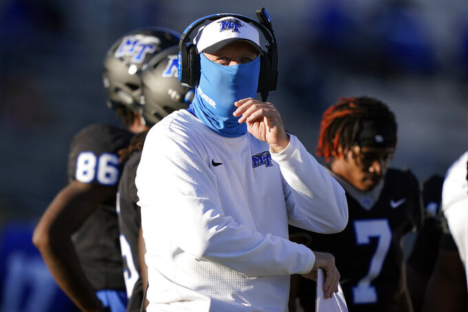 Middle Tennessee head coach Rick Stockstill looks at the scoreboard in the first half of an NCAA college football game against North Texas Saturday, Oct. 17, 2020, in Murfreesboro, Tenn. (AP Photo/Mark Humphrey)