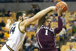 Texas A&M's Savion Flagg, right, and Missouri's Reed Nikko, left, battle for a rebound during the second half of an NCAA college basketball game Tuesday, Jan. 21, 2020, in Columbia, Mo. Texas A&M won the game 66-64. (AP Photo/L.G. Patterson)
