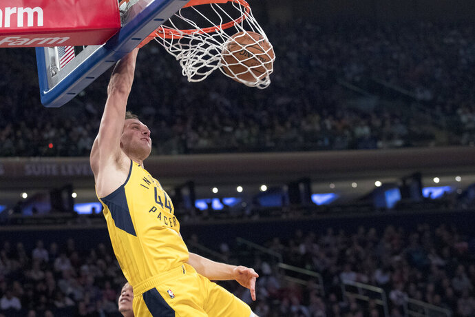 Indiana Pacers forward Bojan Bogdanovic dunks during the first half of the team's NBA basketball game against the New York Knicks, Friday, Jan. 11, 2019, at Madison Square Garden in New York. (AP Photo/Mary Altaffer)