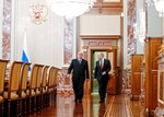 Russian President Vladimir Putin, right, and new Russian Prime Minister Mikhail Mishustin arrive to attend a new cabinet meeting in Moscow, Russia, Tuesday, Jan. 21, 2020. Putin formed his new Cabinet Tuesday, replacing many of its members but keeping his foreign, defense and finance ministers in place. (Dmitry Astakhov, Sputnik, Government Pool Photo via AP)