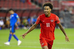 Canada's Tajon Buchanan celebrates scoring against El Salvador during the second half of a World Cup qualifying soccer match Wednesday, Sept. 8, 2021, in Toronto. (Chris Young/The Canadian Press via AP)