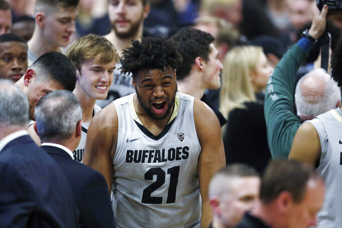 Colorado Buffaloes forward Evan Battey celebrates after the second half of an NCAA college basketball game against USC Saturday, March 9, 2019, in Boulder, Colo. Colorado won 78-67. (AP Photo/David Zalubowski)