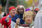 People participate in a performance artwork reenacting the largest slave rebellion in U.S. history in LaPlace, La., Friday, Nov. 8, 2019. The reenactment was conceived by Dread Scott, an artist who often tackles issues of racial oppression and injustice. Scott says that those who took part in the 1811 rebellion were