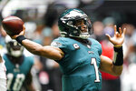 Philadelphia Eagles quarterback Jalen Hurts (1) works in the p[ocket against the Atlanta Falcons during the first half of an NFL football game, Sunday, Sept. 12, 2021, in Atlanta. (AP Photo/John Bazemore)