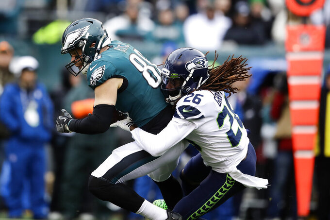 Philadelphia Eagles' Zach Ertz (86) is tackled by Seattle Seahawks' Shaquill Griffin (26) during the first half of an NFL football game, Sunday, Nov. 24, 2019, in Philadelphia. (AP Photo/Matt Rourke)