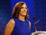 FILE - In this Oct. 15, 2018, file photo, U.S. Rep. Martha McSally, R-Ariz., goes over the rules in a television studio prior to a televised debate with U.S. Rep. Kyrsten Sinema, D-Ariz., in Phoenix. Democratic Rep. Kyrsten Sinema has won Arizona's open U.S. Senate seat, defeating McSally. The race between Sinema and McSally was one of the most-watched in the nation. (AP Photo/Matt York, File)