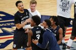 Butler's Chuck Harris (3) celebrates with teammates after an NCAA college basketball game against Xavier in the Big East conference tournament Wednesday, March 10, 2021, in New York. Butler won 70-69. (AP Photo/Frank Franklin II)