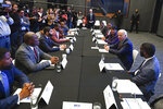 Former Vice President and 2020 Democratic presidential candidate Joe Biden, second from right, visits with an assembly of Southern black mayors Thursday, Nov. 21, 2019 in Atlanta. (AP Photo/John Amis)