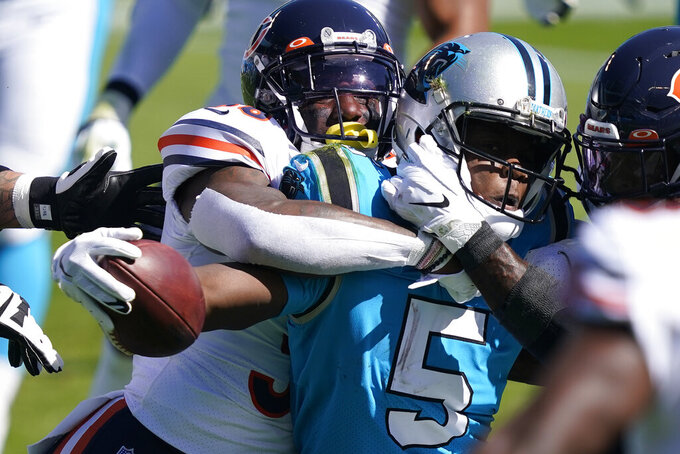 Chicago Bears strong safety Tashaun Gipson tackles Carolina Panthers quarterback Teddy Bridgewater (5) during the first half of an NFL football game in Charlotte, N.C., Sunday, Oct. 18, 2020. (AP Photo/Brian Blanco)