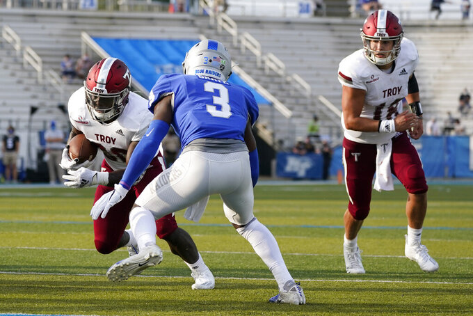 Troy running back DK Billingsley (20) scores a touchdown against Middle Tennessee safety Gregory Grate Jr. (3) in the second half of an NCAA college football game Saturday, Sept. 19, 2020, in Murfreesboro, Tenn. Troy won 47-14. (AP Photo/Mark Humphrey)
