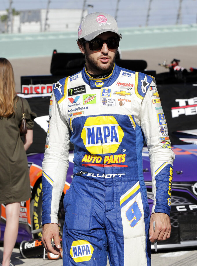 Chase Elliott walks along pit road before the NASCAR Series Championship auto race at the Homestead-Miami Speedway, Sunday, Nov. 18, 2018, in Homestead, Fla. (AP Photo/Lynne Sladky)
