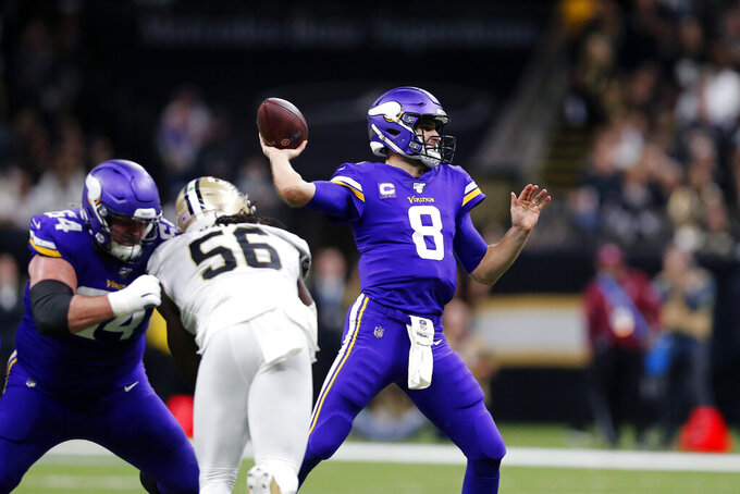 Minnesota Vikings quarterback Kirk Cousins (8) passes under pressure from New Orleans Saints outside linebacker Demario Davis (56) in the first half of an NFL wild-card playoff football game, Sunday, Jan. 5, 2020, in New Orleans. (AP Photo/Brett Duke)