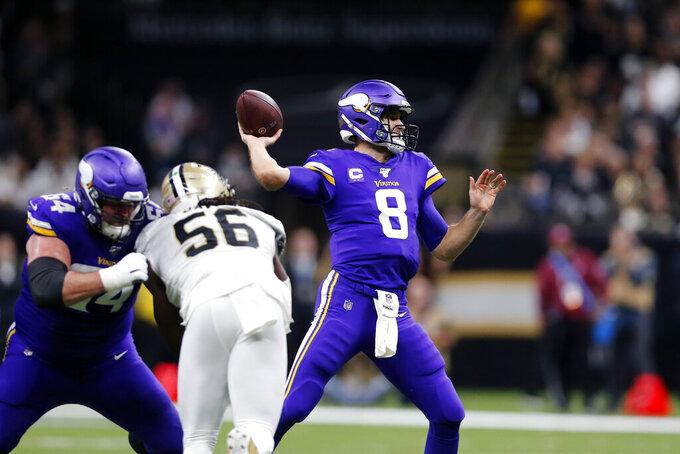 Minnesota Vikings quarterback Kirk Cousins (8) passes under pressure from New Orleans Saints outside linebacker Demario Davis (56) in the first half of an NFL wild-card playoff football game, Sunday, Jan. 5, 2020, in New Orleans. (AP Photo/Brett Duke)