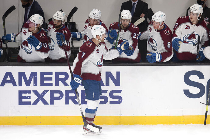 Colorado Avalanche defenseman Devon Toews is congratulated for his goal during the second period of the team's NHL hockey game against the Los Angeles Kings on Tuesday, Jan. 19, 2021, in Los Angeles. (AP Photo/Kyusung Gong)