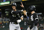 Chicago White Sox's Ryan Cordell, left, and Danny Mendick celebrate Cordell's two-run home run off Minnesota Twins pitcher Ryne Harper during the 12th inning of a baseball game Tuesday, Sept. 17, 2019, in Minneapolis. The Twins won 9-8 in the 12 innings. (AP Photo/Jim Mone)
