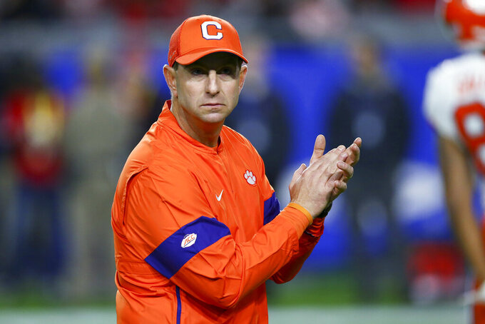 FILE - In this Dec. 28, 2019, file photo, Clemson coach Dabo Swinney watches players warm up for the team's Fiesta Bowl NCAA college football playoff semifinal against Ohio State in Glendale, Ariz. The top-ranked Tigers are 29-1 over the past two seasons and have won five straight ACC championships. (AP Photo/Ross D. Franklin, File)