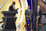 Inductee Chris Bosh holds up a ring to give to Pat Riley, right, as Ray Allen looks on during the 2021 Basketball Hall of Fame Enshrinement ceremony, Saturday, Sept. 11, 2021, in Springfield, Mass. (AP Photo/Jessica Hill)