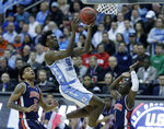 North Carolina's Nassir Little, center, heads to the basket as Auburn's Chuma Okeke (5) and Jared Harper (1) defend during the first half of a men's NCAA tournament college basketball Midwest Regional semifinal game Friday, March 29, 2019, in Kansas City, Mo. (AP Photo/Charlie Riedel)