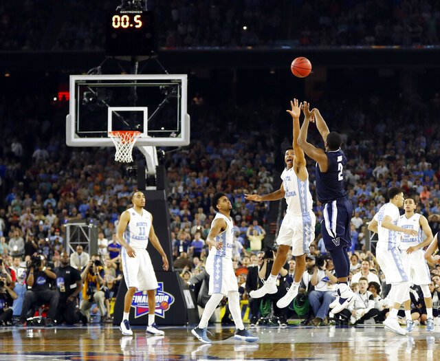 FILE - In this April 4, 2016, file photo, Villanova's Kris Jenkins makes the game-winning three-point shot during the second half of the NCAA Final Four college basketball championship game against North Carolina, in Houston. A panel of Associated Press sports writers has come up with the top 10 men's basketball games in the history of the NCAA Tournament. The top game on the list is Villanova's buzzer-beating victory against North Carolina in the 2016 national championship game. (AP Photo/David J. Phillip, File)