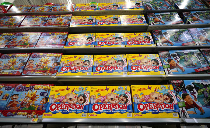 FILE- In this Nov. 9, 2018, file photo Operation made by Hasbro is displayed shelves in the expanded toy section at a Walmart Supercenter in Houston. Shares of Hasbro are plunging after the company said the trade war is hammering its supply chain. The toymaker on Tuesday reported third-quarter net income of $212.9 million, or $1.67 per share. (AP Photo/David J. Phillip, File)
