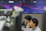 A currency trader watches monitors at the foreign exchange dealing room of the KEB Hana Bank headquarters in Seoul, South Korea, Monday, Dec. 9, 2019. Asian shares were mostly higher Monday cheered by a buying mood on Wall Street that came at the end of last week. (AP Photo/Ahn Young-joon)