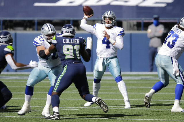 Dallas Cowboys quarterback Dak Prescott passes as Seattle Seahawks defensive end L.J. Collier blocks during the first half of an NFL football game, Sunday, Sept. 27, 2020, in Seattle. (AP Photo/John Froschauer)