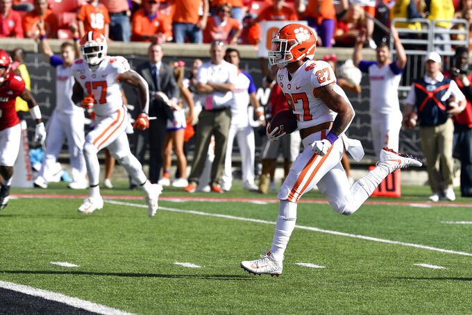 Clemson running back Chez Mellusi (27) runs in for a touchdown during the second half of an NCAA college football game in Louisville, Ky., Saturday, Oct. 19, 2019. Clemson won 45-10. (AP Photo/Timothy D. Easley)