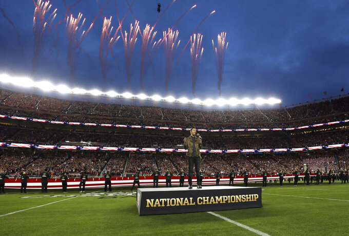 Andy Grammar sings the national anthem before the NCAA college football playoff championship game between Alabama and Clemson, Monday, Jan. 7, 2019, in Santa Clara, Calif. (AP Photo/David J. Phillip)
