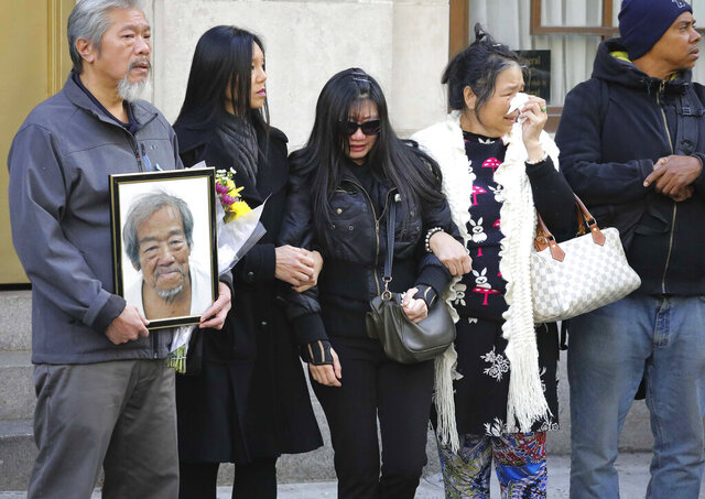 FILE - In this Oct. 18, 2019 file photo, mourners gather at a funeral service for Chuen Kok at the Ng Fook Funeral Home in New York. Kok, an 83-year-old homeless man whom Chinatown residents warmly greeted as