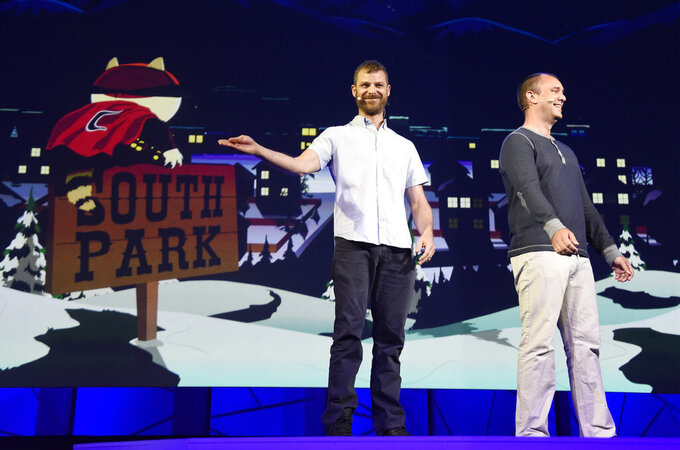 """FILE- In this June 15, 2015, file photo, """"South Park"""" creators Matt Stone, left, and Trey Parker discuss the """"South Park: The Fractured But Whole"""" video game onstage at Ubisoft's E3 2015 Conference at the Orpheum Theatre in Los Angeles. In an interview with Colorado Gov. Jared Polis, Friday, Aug. 13, 2021, Stone and Parker said they had come to an agreement with the current owners of the Casa-Bonita restaurant that was featured on the show. The suburban Denver restaurant had closed to diners in March 2020 due to the pandemic and declared bankruptcy in the spring. (Photo by Chris Pizzello/Invision/AP, File)"""