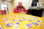 Poll worker Bill Martens mans the ballot machine and