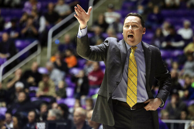 FILE - In this Jan. 4, 2018, file photo, Northern Arizona coach Jack Murphy calls to his team during the first half of an NCAA college basketball game against Weber State, in Ogden, Utah. Northern Arizona won 10 games last season, yet made enough progress for coach Jack Murphy to keep his job for the final year of his contract. He knows the upward trend will have to continue for there to be another contract. (Matt Herp/Standard-Examiner via AP, File)