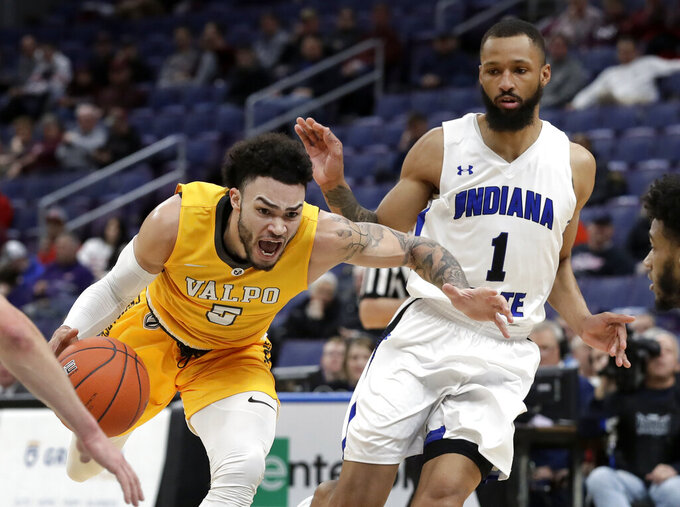 Valparaiso's Markus Golder, left, heads to the basket past Indiana State's Allante Holston (1) during the first half of an NCAA college basketball game in the first round of the Missouri Valley Conference men's tournament Thursday, March 7, 2019, in St. Louis. (AP Photo/Jeff Roberson)