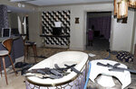 FILE - This October 2017 file evidence photo released by the Las Vegas Metropolitan Police Department Force Investigation Team Report shows the interior of Stephen Paddock's 32nd floor room of the Mandalay Bay hotel in Las Vegas after a mass shooting. Accounts of police collecting bullet fragments and tracing the shooter's gun purchases are among newly released records from the Oct. 2017 deadliest mass shooting in modern U.S. history. The more than 750 pages of documents distributed Wednesday, March 20, 2019, by Las Vegas police don't provide new information about a reason for the carnage that killed 58 people and injured more than 850. (Las Vegas Metropolitan Police Department via AP, File)