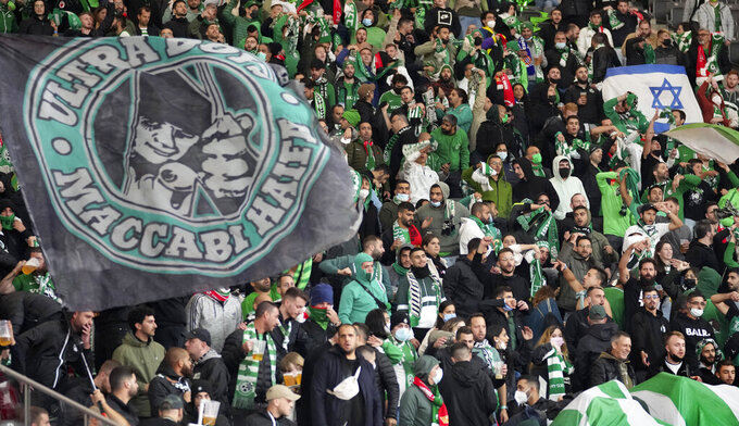 Supporters of Haifa attend a group E Europa Conference League soccer match between 1. FC Union Berlin and Maccabi Haifa FC in Berlin, Germany, Thursday, Sept. 30, 2021. (AP Photo/Michael Sohn)