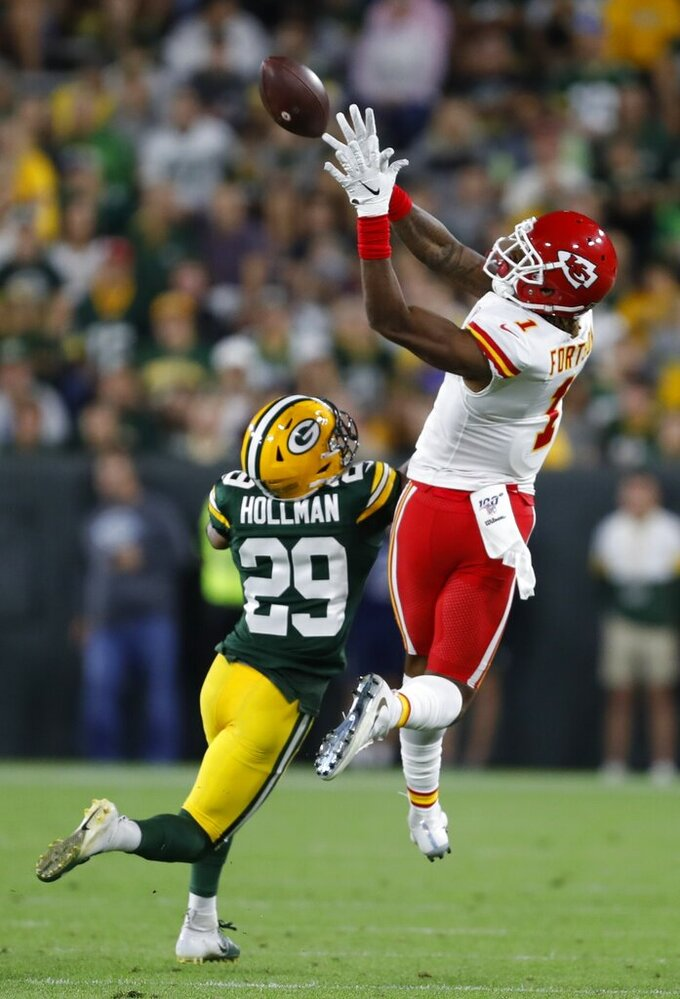 Kansas City Chiefs' Jody Fortson catches a pass over Green Bay Packers' Ka'Dar Hollman during the first half of a preseason NFL football game Thursday, Aug. 29, 2019, in Green Bay, Wis. (AP Photo/Matt Ludtke)