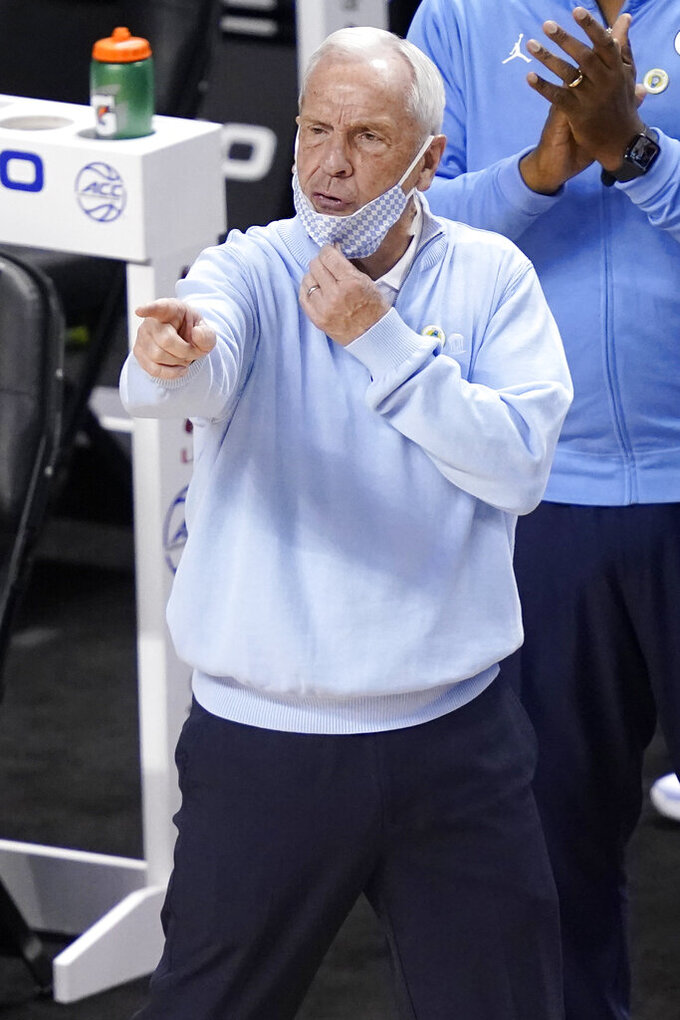 North Carolina head coach Roy Williams directs his team during the first half of an NCAA college basketball game in the second round of the Atlantic Coast Conference tournament in Greensboro, N.C., Wednesday, March 10, 2021. (AP Photo/Gerry Broome)
