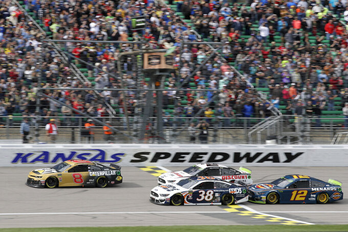 Daniel Hemric (8) takes the green flag with David Ragan (38), Brad Keselowski (2) and Ryan Blaney (12) during a NASCAR Cup Series auto race at Kansas Speedway in Kansas City, Kan., Sunday, Oct. 20, 2019. (AP Photo/Orlin Wagner)