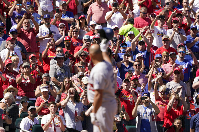 Los Angeles Dodgers' Albert Pujols tips his cap to cheering fans as he steps up to bat during the seventh inning of a baseball game against the St. Louis Cardinals Thursday, Sept. 9, 2021, in St. Louis. (AP Photo/Jeff Roberson)