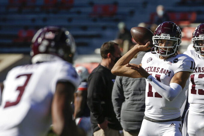 Texas A&M quarterback Kellen Mond (11) warms up before the start of an NCAA college football game against Auburn on Saturday, Dec. 5, 2020, in Auburn, Ala. (AP Photo/Butch Dill)