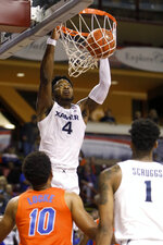 Xavier's Tyrique Jones goes up for a dunk against the defense of Florida's Noah Locke in the first half of an NCAA college basketball game during the finals of the Charleston Classic Sunday, Nov. 24, 2019, in Charleston, SC. (AP Photo/Mic Smith)
