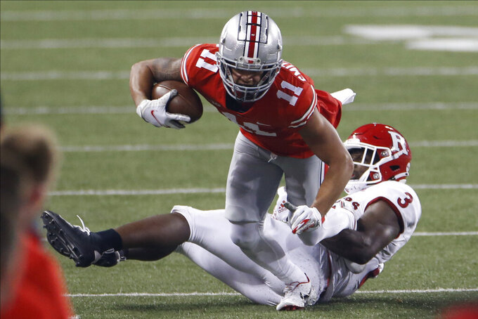 Rutgers linebacker Olakunle Fatukasi, right, tackles Ohio State receiver Jaxon Smith-Njigba during the second half of an NCAA college football game Saturday, Nov. 7, 2020, in Columbus, Ohio. Ohio State won 49-27. (AP Photo/Jay LaPrete)