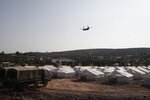 A Greek Army helicopter carrying the European Council President Charles Michel flies over the new temporary refugee camp in Kara Tepe on the northeastern island of Lesbos, Greece, Tuesday, Sept. 15, 2020. Greece has called on the European Union to jointly run new refugee camps being built on its eastern islands as part of a planned overhaul of the bloc's migration policy. (Dimitris Tosidis/Pool via AP)