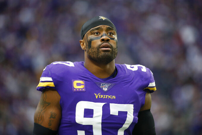 FILE - In this Sept. 22, 2019 file photo, Minnesota Vikings defensive end Everson Griffen stands on the field before an NFL football game against the Oakland Raiders in Minneapolis.  After a rough 2018 season when he went on hiatus for mental health treatment, Griffen has been playing as strong as ever in his 10th year in the league. (AP Photo/Bruce Kluckhohn, File)