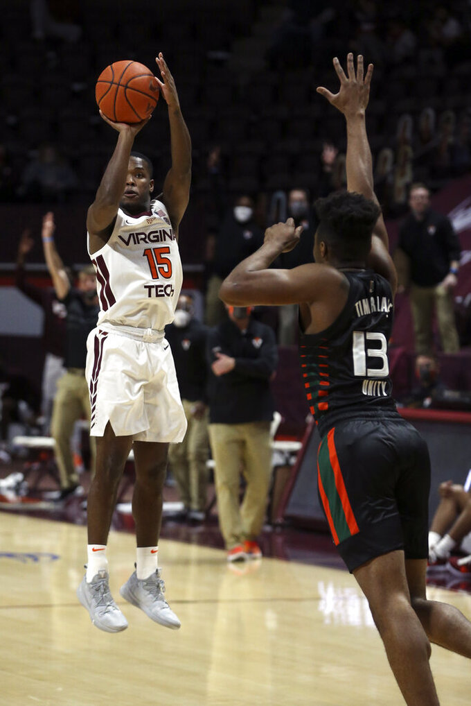 Virginia Tech's Jalen Cone (15) shoots a 3-point basket over Miami's Earl Timberlake (13) during the first half of an NCAA college basketball game, Tuesday, Dec. 29, 2020 in Blacksburg, W.Va. (Matt Gentry/The Roanoke Times via AP, Pool)