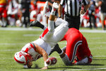 Miami of Ohio quarterback Brett Gabbert, left, is sacked by Cincinnati linebacker Bryan Wright, right, in the first half of an NCAA college football game, Saturday, Sept. 14, 2019, in Cincinnati. (AP Photo/John Minchillo)